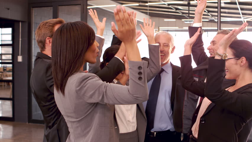 Happy business people high fiving in the office | Shutterstock HD Video #13775408