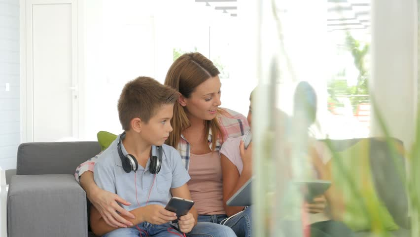 Mother with kids playing with digital tablet #13777718