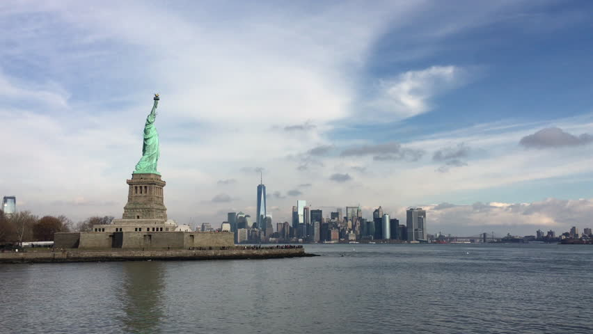 Statue of Liberty seen in Hudson bay with NYC in background 4k   Shutterstock HD Video #13804838