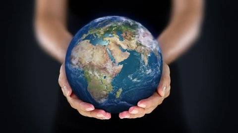 Female hand holding a realistic Earth. Starting in North America. The Earth globe starts showing Europe and is loopable from frame 98 to frame 547.