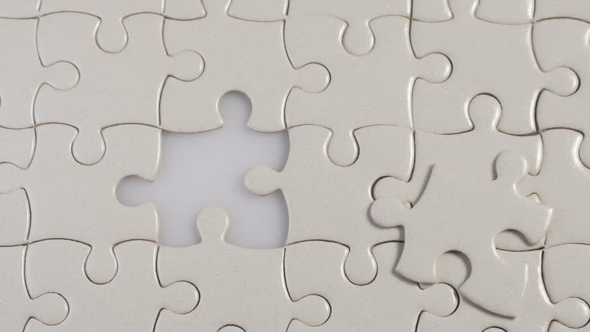 Puzzle piece coming down into it's place. Business concept for key completion for business success.