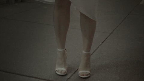 close-up of Marilyn Monroe shoes white dress and face on New York City street at night in 1080 HD