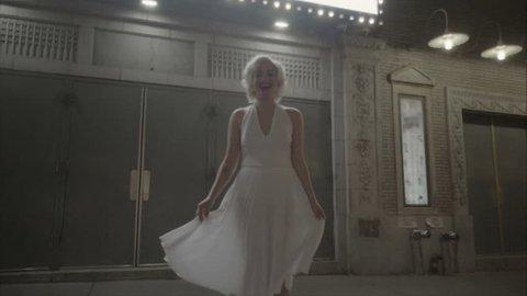 Marilyn Monroe beautiful under street lights outside theater in slow motion 1080 HD