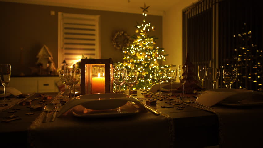 4k footage slow dolly move of lighted christmas tree with decorated dinner table in living - Lighted Christmas Presents