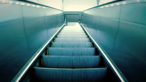 Modern escalator stairs moving up, pov perspective