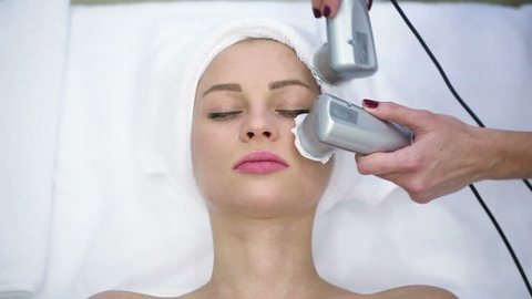 High frequency skin treatment of female face in spa