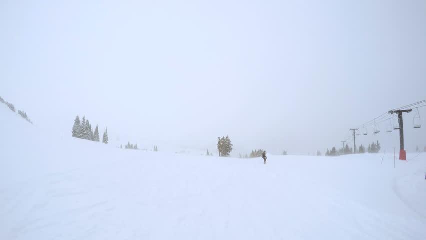 Alpine skiing in fresh powder during snow storm.   Shutterstock HD Video #13942088