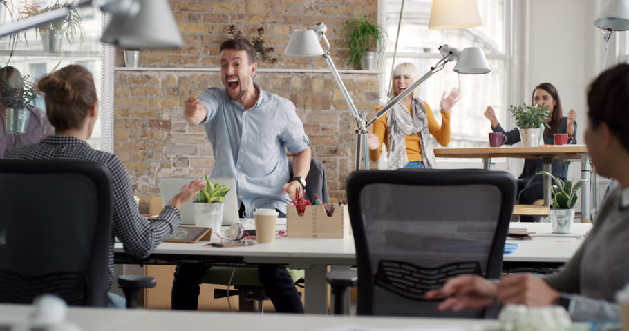 Businessman with arms raised celebrating success watching sport victory on laptop diverse people group clapping expressing excitement in office | Shutterstock HD Video #13947470