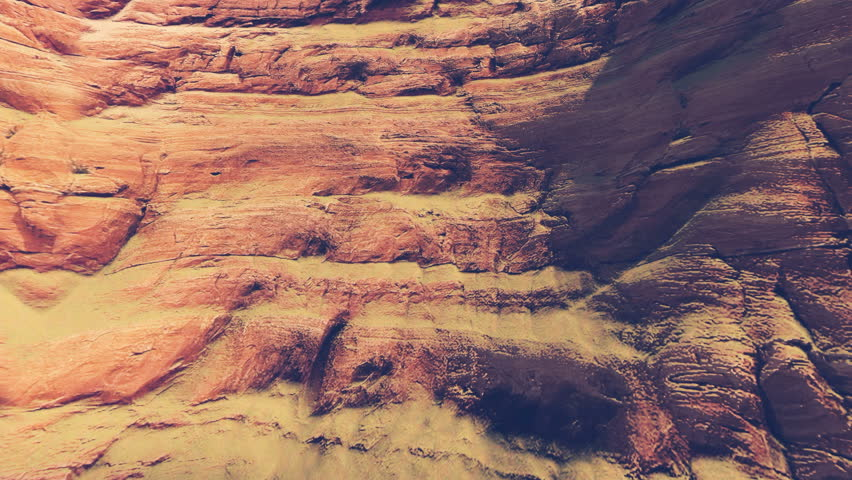 Close up view of the red striped rock formations in a canyon during daytime. Realistic three dimensional animation, sliding upward shot. #13950275