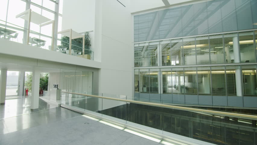 contemporary office building. 4k ultra hd version interior view of a large contemporary office building with glass partitions