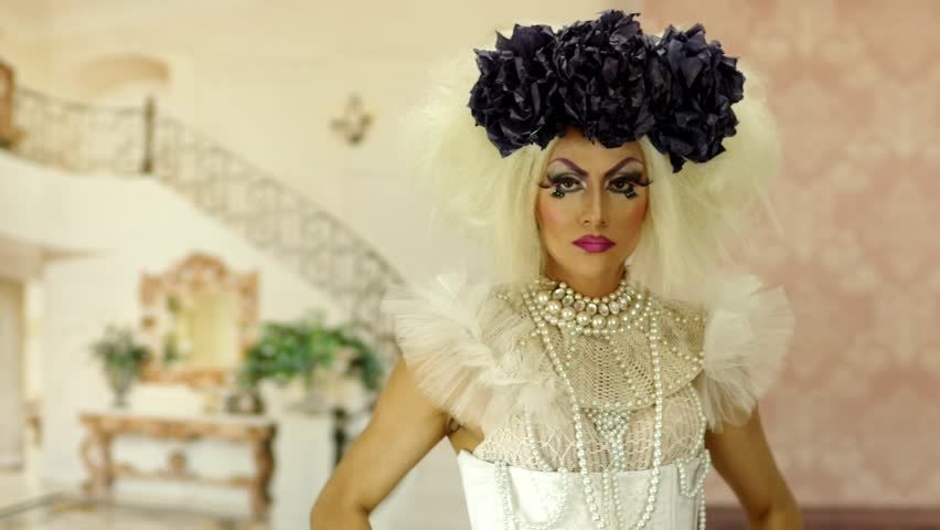 Drag queen with a glamorous and spectacular look doing some great acting and interacting for camera