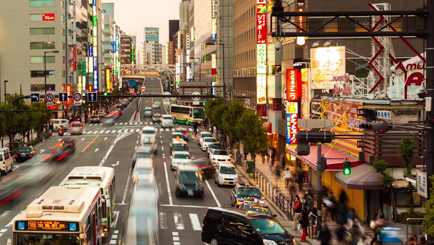 OSAKA - MAR 30: Timelapse view of traffic moving through the city. Osaka is Japans second largest city and a major commercial center. On March 30, 2012 in Osaka, Japan.
