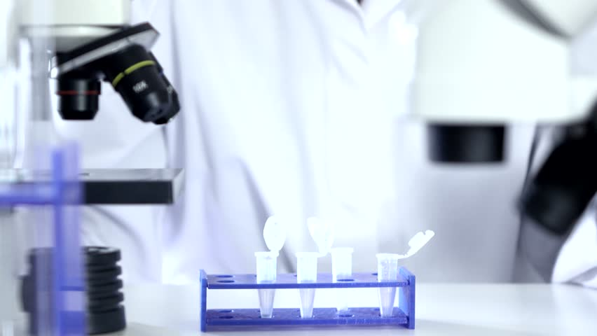 Medical research student using a laboratory pipette and test tube #13964828