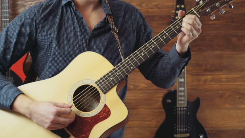 Man Playing The Acoustic Guitar Slow Motion