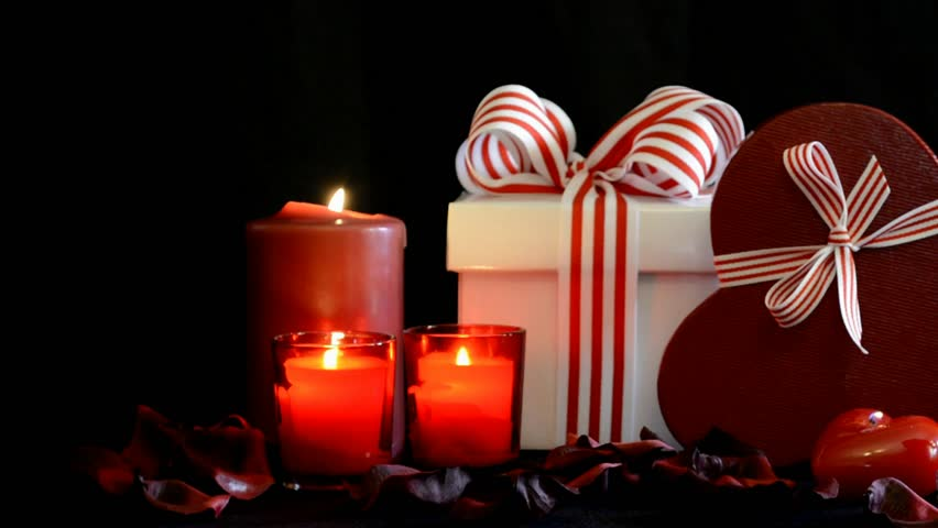 romantic valentine gifts with burning candles on black background zoom in hd stock