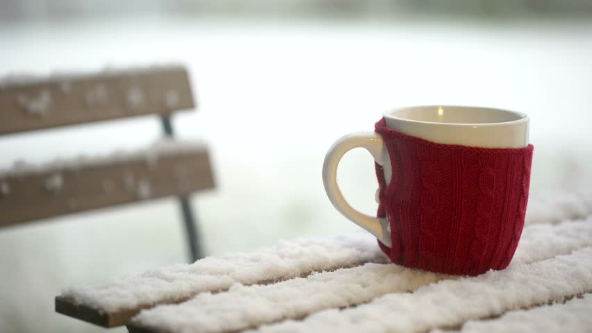 Cup Of Coffee On A Wooden Table While Snowing Bistrot