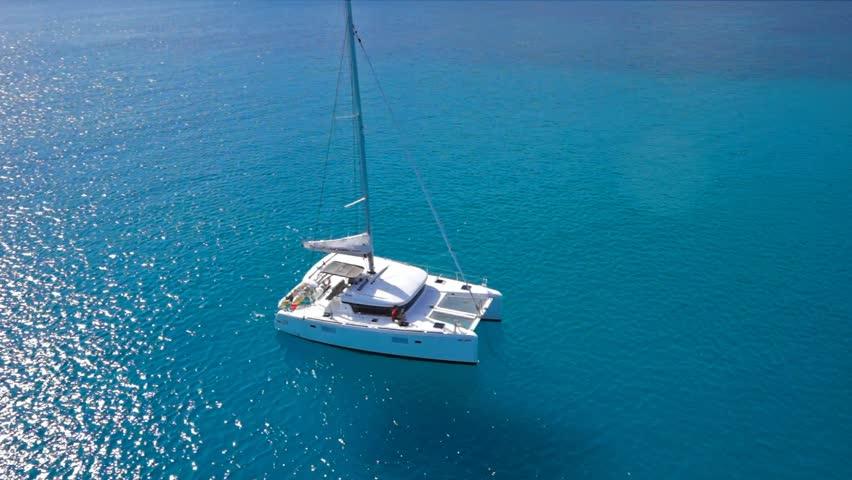 Catamaran sailing in opened sea of Seychelles | Shutterstock HD Video #13998785