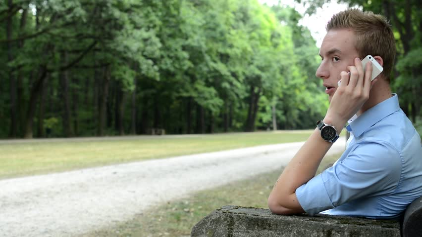 Man sits and call with smartphone in the park | Shutterstock HD Video #14002988