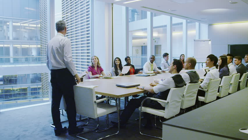 4k / Ultra HD version Diverse business team in boardroom meeting in a large contemporary office building Shot on RED Epic | Shutterstock HD Video #14005385