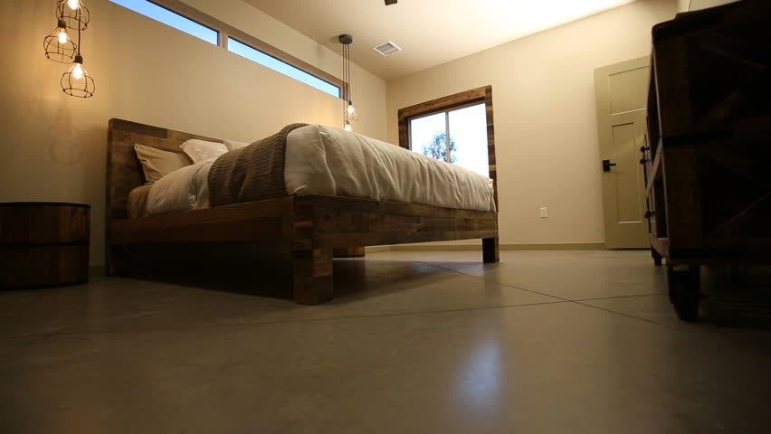 Bedroom Rising Shot On Bed From Low Angle. Camera Rises From The Floor In A  Bedroom To Reveal The Bed And Modern Decoration To Ceiling With Ceiling Fan  ...