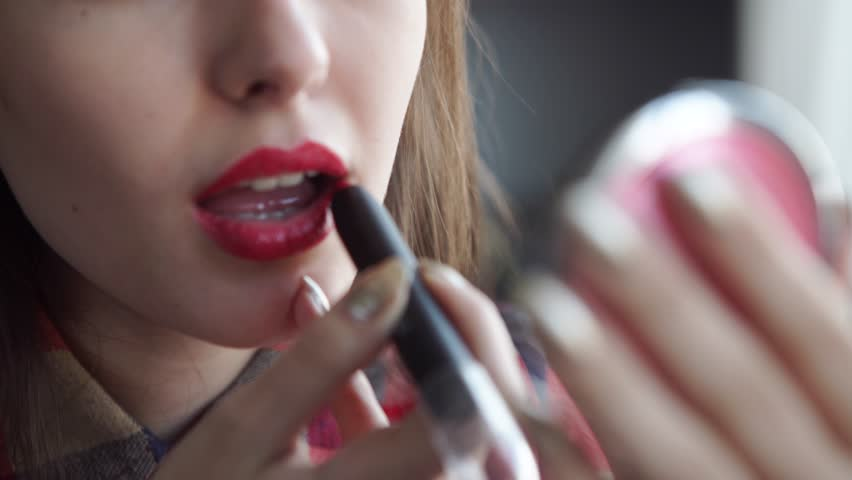 young woman red lips and lipstick