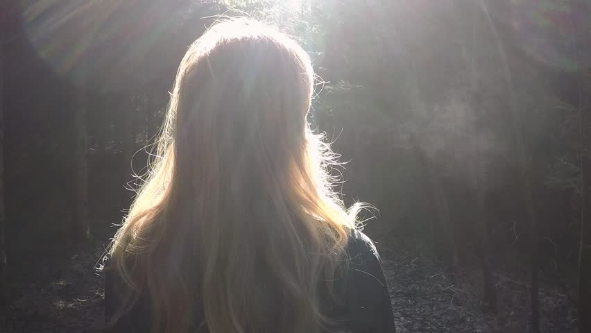 Blonde women breathing air in the cold sunny morning woods. Slow motion effect used.  | Shutterstock HD Video #14040458