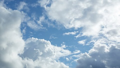 Only sky with cumulus clouds. Fluffy clouds slowly fly on the blue sky. Timelapse 4K