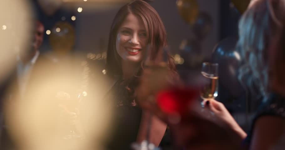 Beautiful woman dancing having fun at glamorous sexy party drinking alcohol celebrating holidays