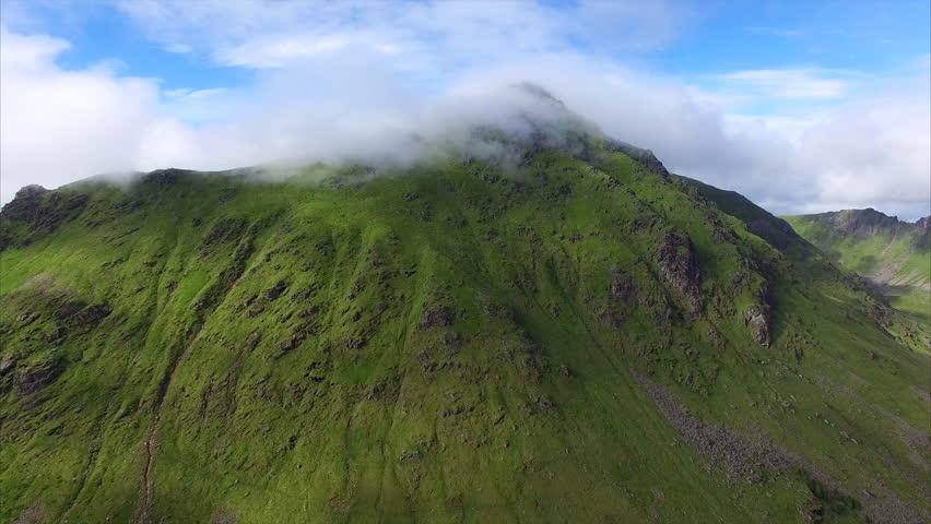 Aerial View Of Dense Clouds Flying Over Mountain Top On Lofoten ...