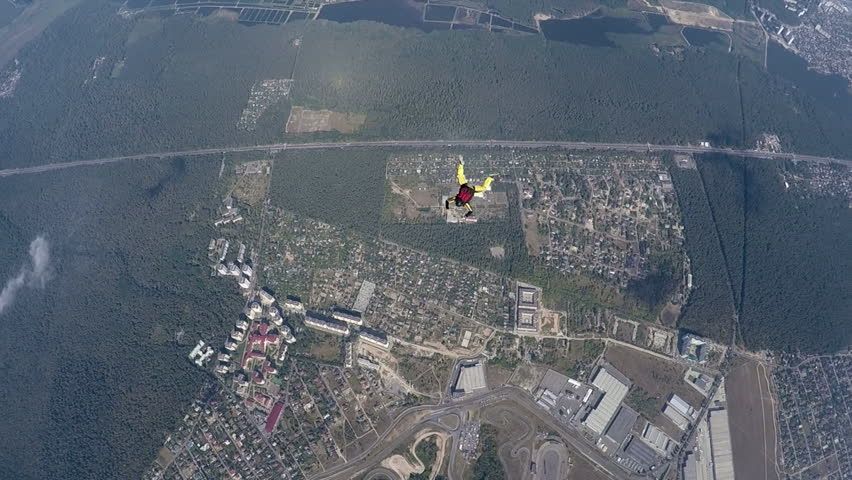 Skydiver rotation above the land during accelerated free fall course. Slow motion | Shutterstock HD Video #14100248
