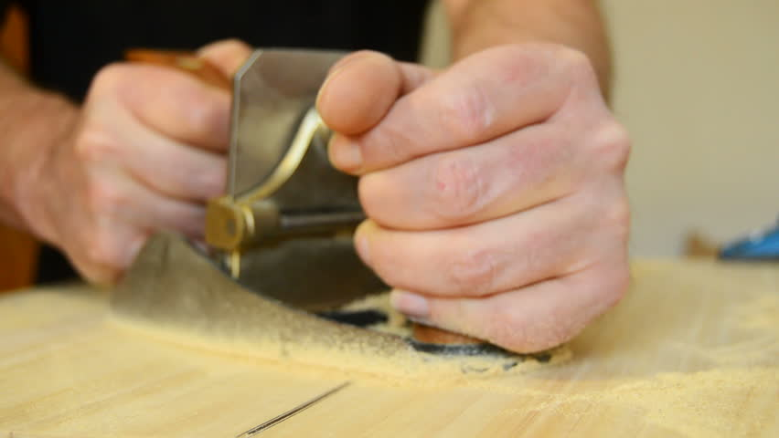 Luthier Working With A Wood Planer In Flamenco Guitar