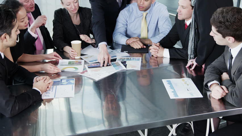 4k / Ultra HD version A confident and happy business team of mixed ages and ethnicity are holding a meeting in a light, modern office building. In slow motion. Shot on RED Epic | Shutterstock HD Video #14127668