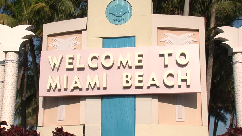 'Welcome to Miami Beach' sign, zoom out and static at end | Shutterstock HD Video #14127698