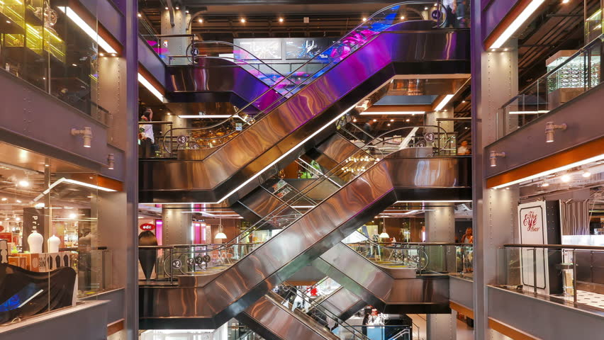 BANGKOK / THAILAND - JAN 27 2016 : Time-Lapse of People using the escalators in Siam Center Shopping Mall Bangkok.