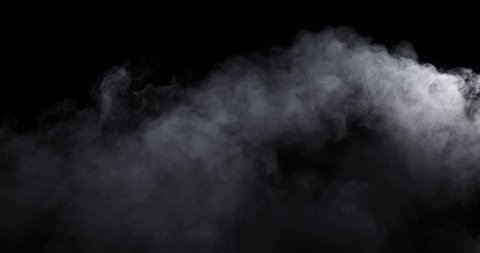 Smoke - 4K - long. Medium dense smoke over a black background. Totally appearing from the bottom and filling the lower part of the frame. 120 fps Real shot