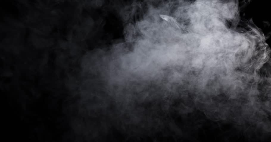Smoke - 4K - long. Dense smoke over a black background. Totally appearing from the bottom and disappearing. 120 fps Real shot