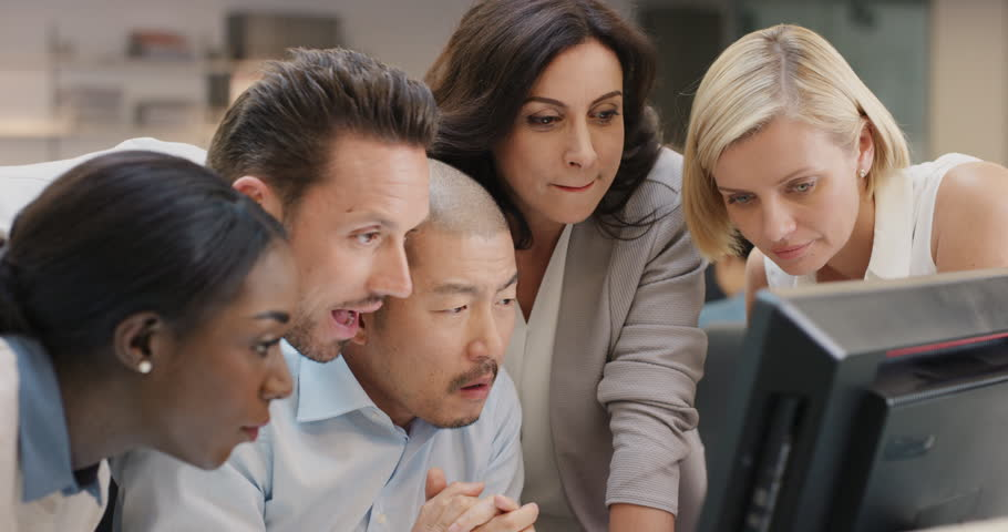 Creative business team meeting happy people working in modern office late at night discussing strategy using computer touch screen in diverse gender group | Shutterstock HD Video #14141774