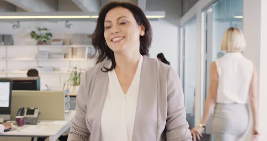 Beautiful businesswoman checking smart watch leaving busy office meeting achievement success smiling happiness | Shutterstock HD Video #14142863