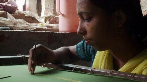 Baruipur, India - CIRCA 2013 - Indian women embroidering fabric