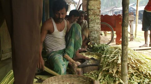Baruipur, India - CIRCA 2013 - Three men making plant based crafts