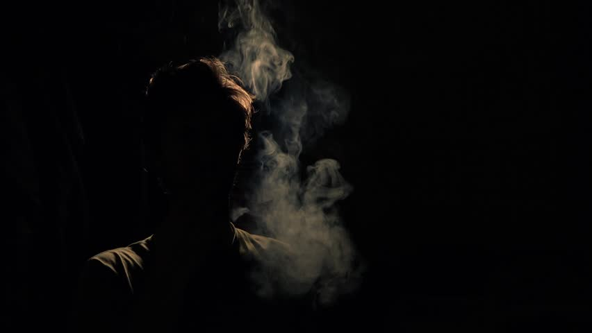 Back lit silhouette man smoking stock footage video 100 royalty free 14219258 shutterstock - Dark smoking wallpapers ...
