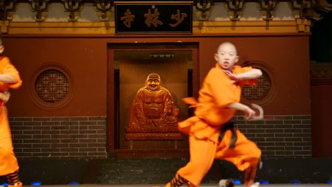 Dec.18,2015-Dengfeng,China: Shaolin temple monks are practicing martial skills on the stage for the tourists