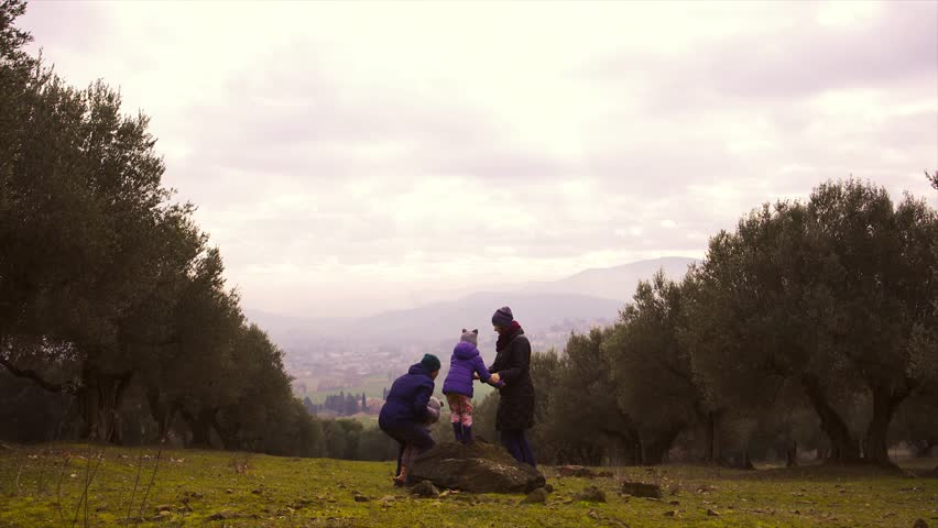 Family with two little children having fun in autumn garden | Shutterstock HD Video #14308138