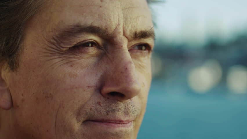 Middle-aged man looks out over the ocean. | Shutterstock HD Video #14309218