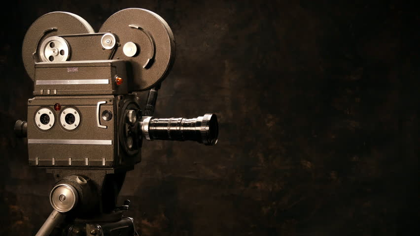 Vintage Hollywood Movie Camera in Front of Black Backdrop. Suitable for Film Title, Credits or Tv Show. | Shutterstock HD Video #14332348