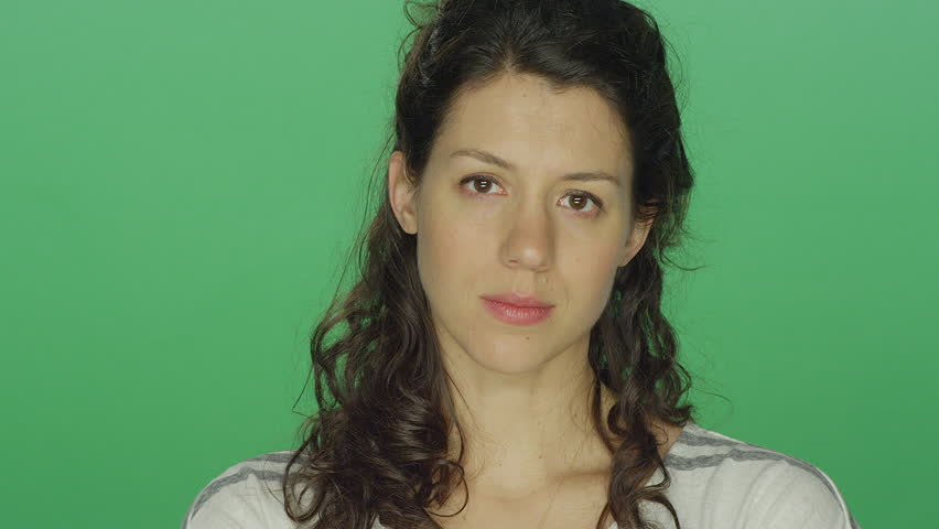 Young woman looking sad, on a green screen studio background | Shutterstock HD Video #14360428