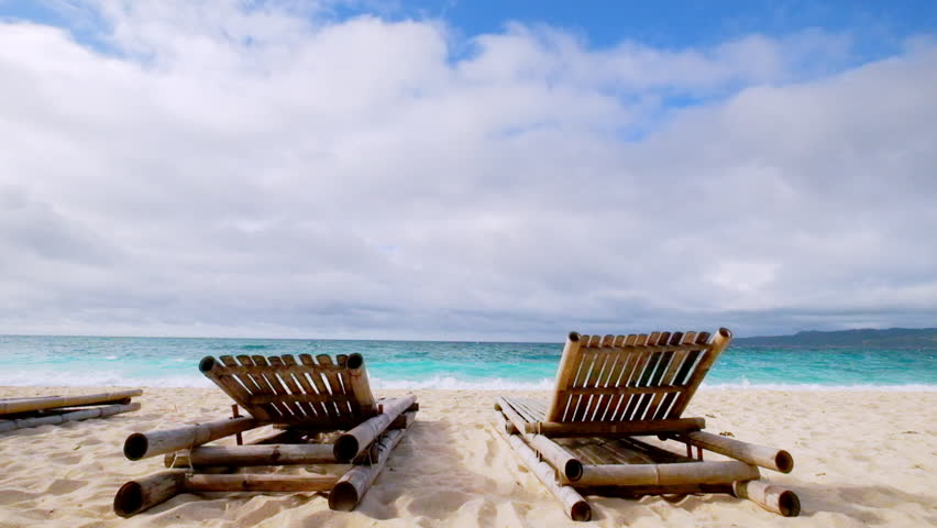 Amazing tropical beach landscape with chairs for relaxation on sand. Boracay island, Philippines summer vacation