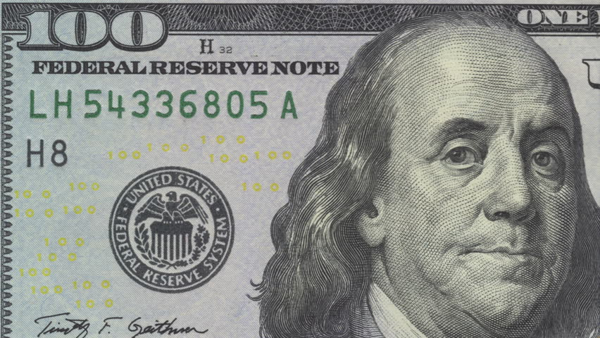 Slow zoom to close up on US currency money - a $100 dollar bill. | Shutterstock HD Video #14418028