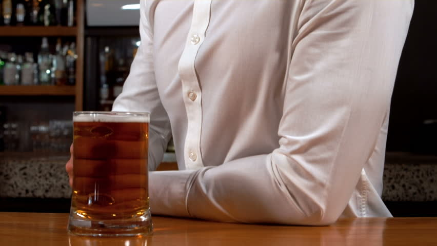 Thoughtful businessman drinking a glass of beer in bar | Shutterstock HD Video #14426608