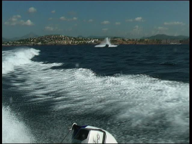 Fast daycruiser jumping backwash of motoryacht take 4